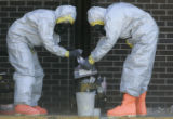 Chemical Agent Specialists with the Civil Support Team from Buckley Air Force Base handle samples...