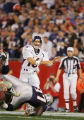 The Denver Broncos Jake Plummer (#16, QB) passes under pressure by the New England Patriots'...