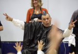 Paul Sandos (cq), principle at Deer Creek Elementary school in Bailey, shows off his mohawk to the...