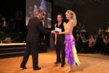 Emcee Ed Greene presents the Judges' Choice Award to Michael Petr and Janet Elway. The couple also...