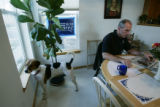 Bob Beauprez pets Petey (their son's dog) while sitting at his kitchen table in Arvada, Colo. on...