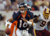 (CANTON, Ohio., SHOT 8/9/2004) The Denver Broncos' Jake Plummer (#16) takes off with the ball as...