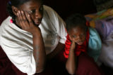 MJM263   Angel Hudson (cq), left, watches television Thursday evening with daughter, Jannette...