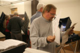 Dan Willis, cq, (rt) looks over voting Test Boards, Thursday Oct. 19, 2006 to test voting machines...