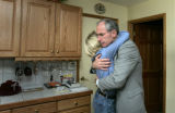 Bob Beauprez gives his wife Claudia a hug before heading to a campaign event in Arvada, Colo. on...