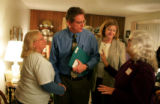 5th Congressional District candidate Jay Fawcett, center, is greeted by supports after a gathering...