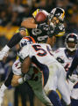 The Pittsburgh Steelers Hines Ward (#86, WR) loses the ball while airborne just before crossing...