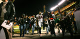 The Denver Broncos Javon Walker (#84, WR) raises the victory sign as he walks off the field after...