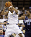 DXA105 - Denver Nuggets forward Kenyon Martin, left, pulls down a rebound in front of Utah Jazz...