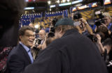 07/26/2004 Boston-Comedian Al Franken, left, and Michael Moore talk while visiting the floor of...