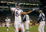 The Denver Broncos Javon Walker (#84, WR) celebrates his third touchdown of the game against the...