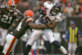 Denver Broncos wide receiver Brandon Marshall, right, makes a reception in the second quarter of...