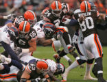 Former Denver Bronco turned Cleveland Browns running back Reuben Droughns, middle #34, leaps over...