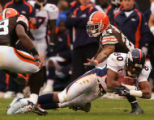 Rod Smith leans forward for extra yardage in the the second quarter of the Denver Broncos against...