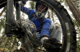 (SILVERTON, Colorado. July 23, 2004) Josh Olsen,24, from Silverton lowers his tire pressure  as he...