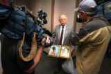 Orlando Martinez, grandfather of the victim, Krystal Martinez, holds two family photos of her...