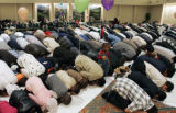The Muslim faithful pray together at a mass prayer at the DTC Marriott Monday morning October 23,...