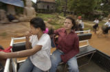 Kampong Thom,  Cambodia.  November 12, 2003.   Son Put, 19, left, and Nane Chan, 26,  ride in the...