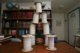 "Yaakov ""Jim"" Watkins, (cq), in his home with his books and his lengths of string. ..."