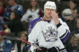JPM246 Los Angeles Kings defenseman Rob Blake, #4, wipes his eyes during a break in play against...