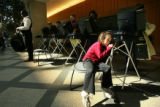 MJM145 Sitting on a chair, Raina Miller, 5, waits for her mother, Tara Miller (cq) to finish...