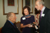 Earthen Vessel Dinner featured entertainer Art Linkletter, left, shares a moment with patrons...