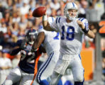 (MAP116)The Indianapolis Colts' Peyton Manning (#18, QB) drops back to pass during the first...