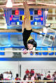(DLM2923) -  Fort Collins High School's Michele Tharp performs on the uneven bars during second...