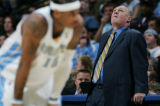 (JPM0168)  Denver Nuggets coach George Karl looks at his team's score against the Minnesota...