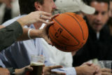(JPM0138)  Denver Nuggets fans look at the new style ball being used this season by the NBA during...