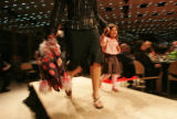 Alora Villarreal (CQ) ,3, gets a young start on the runway with some help from her mother Crystal...