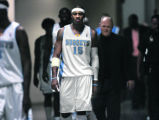 Denver Nuggets forward Carmelo Anthony, MIDDLE, makes his way to the locker room during half-time...