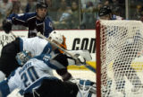 Colorado Avalanche Matthew Barnaby, left, and Alex Tanguay, right, with San Jose Sharks Brad...