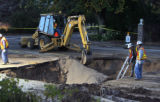 Denver Water Department workers repair a water main break  on S. University Blvd. north of Quincy...