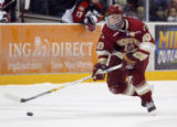 University of Denver Pioneers #10 Ryan Helgason drives the puck down rink during the 1st period.
