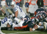 (068) IDenver Broncos quarterback Jake Plummer dives for the Broncos first touch down of the game...