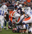 (JPM580) Denver Broncos Mike Bell flips into the end zone on a 1-yard touchdown run in the THIRD...