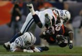 (JPM1455) Denver Broncos Mike Bell, #20 is upended by Indianapolis Colts Marlin Jackson, #28, and...
