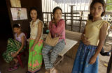 Kampong Thom,  Cambodia.  November 12, 2003.  Brothel owner Polly Chan, center, with three of her...