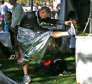 Garland Thurman (cq), of Lonetree, does some stretching after he finished the half marathon in the...