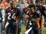 Denver Broncos defensive specialists Champ Bailey, left, and Darrent Williams talk about Bailey's...