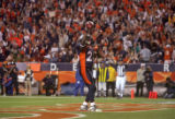 Denver Broncos running back Tatum Bell stands in the endzone after running for a 2 yard touchdown...