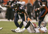 Denver Broncos defensive end Patrick Chukwurah celebrates sacking Oakland Raiders quarterback...
