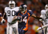 Javon Walker gains yardage on a double-reverse in the second quarter of the Denver Broncos against...