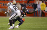 Nick Ferguson almost intercepts a tipped ball byAlvis Whitted in the fourth quarter of the Denver...