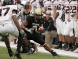 University of Colorado tail back Hugh Charles runs for a first down in the first quarter of play...