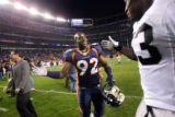 Denver Broncos rookie Elvis Dumervil (#92, DL) shakes hands with the Oakland Raiders' Thomas...