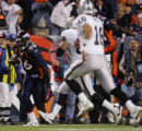 (RMN920) - Oakland Raiders offensive layers pursue Denver Broncos Michael Myers, #96, running with...