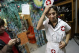 Steve Moreno (cq), 18, a senior at South High School, tries on a nurse's uniform to wear to school...