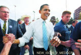 Sen. Barack Obama, D-Ill.,  greets fans as he arrives at Fletcher Plaza in Aurora Tuesday, October...